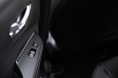 The window opener and the seat heater control of the new Hyundai KONA Hybrid compact SUV.