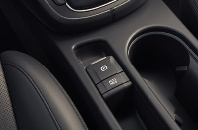 The electric parking brake in the centre console of the new Hyundai KONA Hybrid compact SUV.